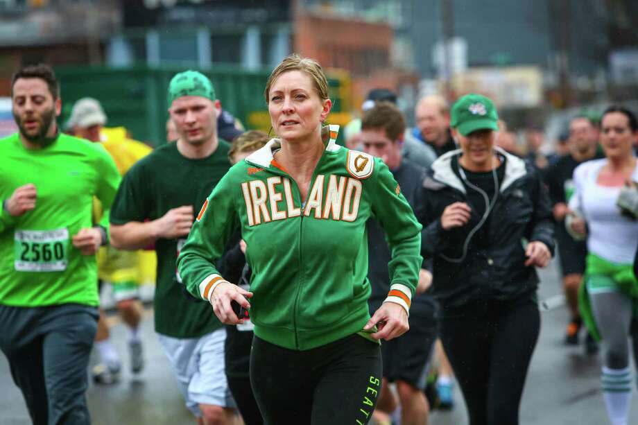Competitors make their way along the course during the annual St. Patrick's Day Dash. Thousands of runners participated in the run on Sunday, March 16, 2014. The event benefits the Detlef Schrempf Foundation. Photo: JOSHUA TRUJILLO, SEATTLEPI.COM / SEATTLEPI.COM