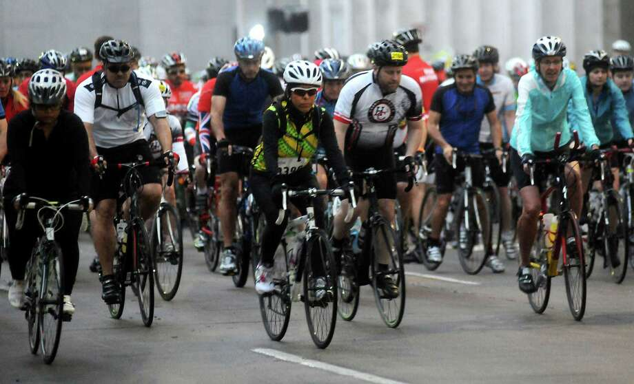 A group of cyclists ride in the annual Tour de Houston bike ride downtown Sunday  March 16, 2014. Photo: Dave Rossman, For The Houston Chronicle / Freelance