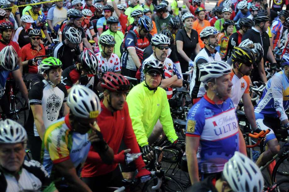 The first wave of cyclists prepare to start at the annual Tour de Houston bike ride downtown Sunday  March 16, 2014. Photo: Dave Rossman, For The Houston Chronicle / Freelance