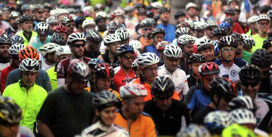 A group of cyclists wait to start the annual Tour de Houston bike ride downtown Sunday  March 16, 2014. Photo: Dave Rossman, For The Houston Chronicle / Freelance