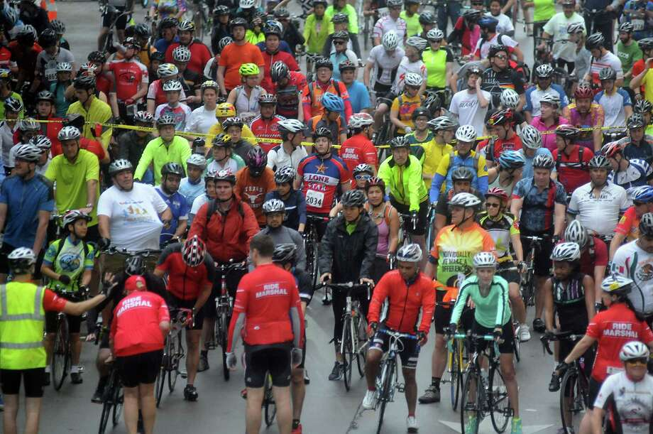 Cyclists prepare to start the annual Tour de Houston bike ride downtown Sunday  March 16, 2014. Photo: Dave Rossman, For The Houston Chronicle / Freelance