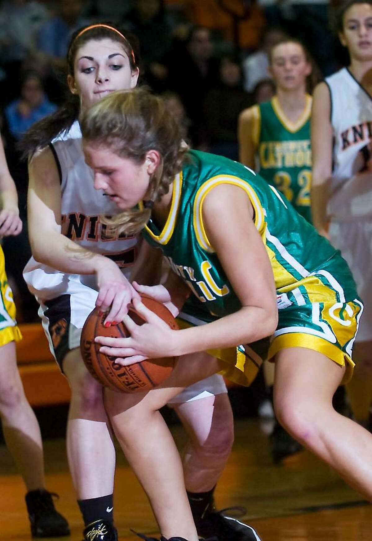 Stamford High School's Brittany Duffin and Trinity Catholic's Clare O'Leary battle for control of the ball during the girls basketball city title game in Stamford, Conn. on Tuesday, Feb. 9, 2010.