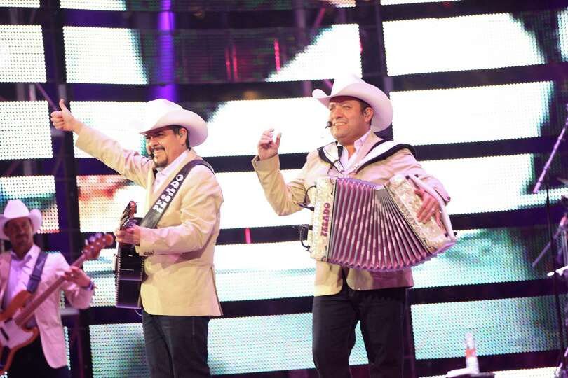 Pepe Elizondo, left, and Beto Zapata with the group Pesado performs during Rodeo Houston at Reliant