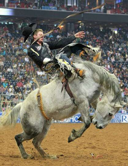 Jake Vold hangs on in the Bareback Riding event during BP Super Series V, Round 1 at Reliant Stadium