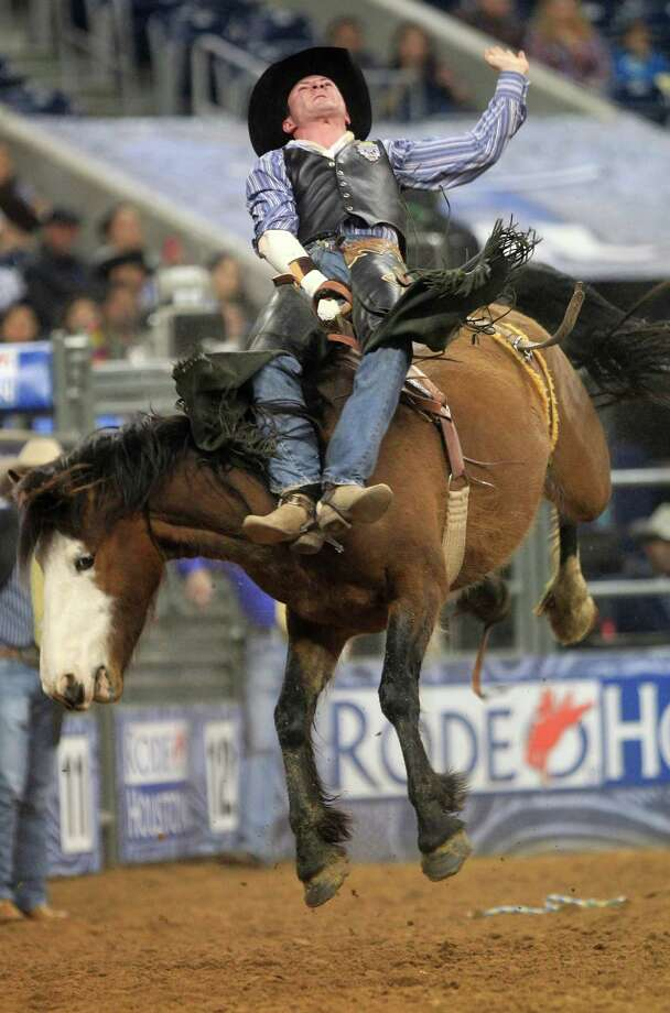 Bill Tutor hangs on in the Bareback Riding event during BP Super Series V, Round 1 at Reliant Stadium  Sunday, March 16, 2014, in Houston. Photo: Johnny Hanson, Houston Chronicle / © 2014  Houston Chronicle