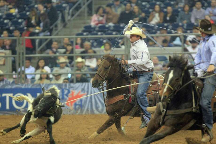 Team Roping duo Mitchell and Adams rope a steer in 4.8 seconds to put them in first place during the BP Super Series V, Round 1 at Reliant Stadium  Sunday, March 16, 2014, in Houston. Photo: Johnny Hanson, Houston Chronicle / © 2014  Houston Chronicle