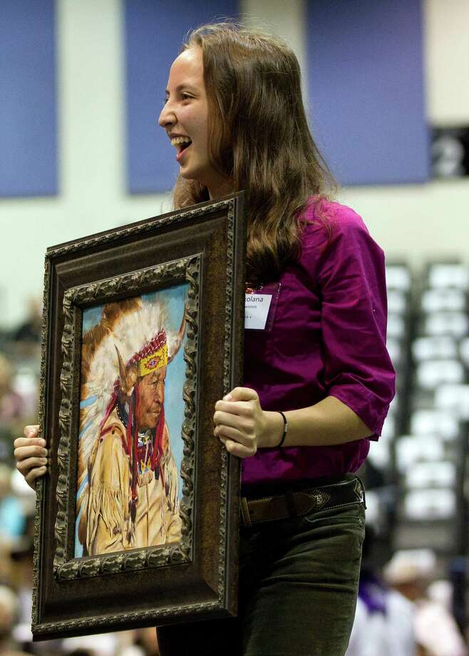"Lot 4 Class Champion, Roxolana Krywonos  from Seven Lakes High School shows her mixed medium art piece titled ""Chief,"" during the Houston Livestock Show and Rodeo School Art Auction Sunday, March 16, 2014, in Houston. Photo: Johnny Hanson, Houston Chronicle / © 2014  Houston Chronicle"