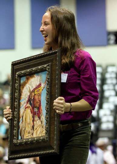 Lot 4 Class Champion, Roxolana Krywonos  from Seven Lakes High School shows her mixed medium art pie