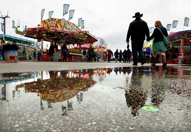Rain falls on the Houston Livestock Show and Rodeo midway Sunday, March 16, 2014, in Houston.