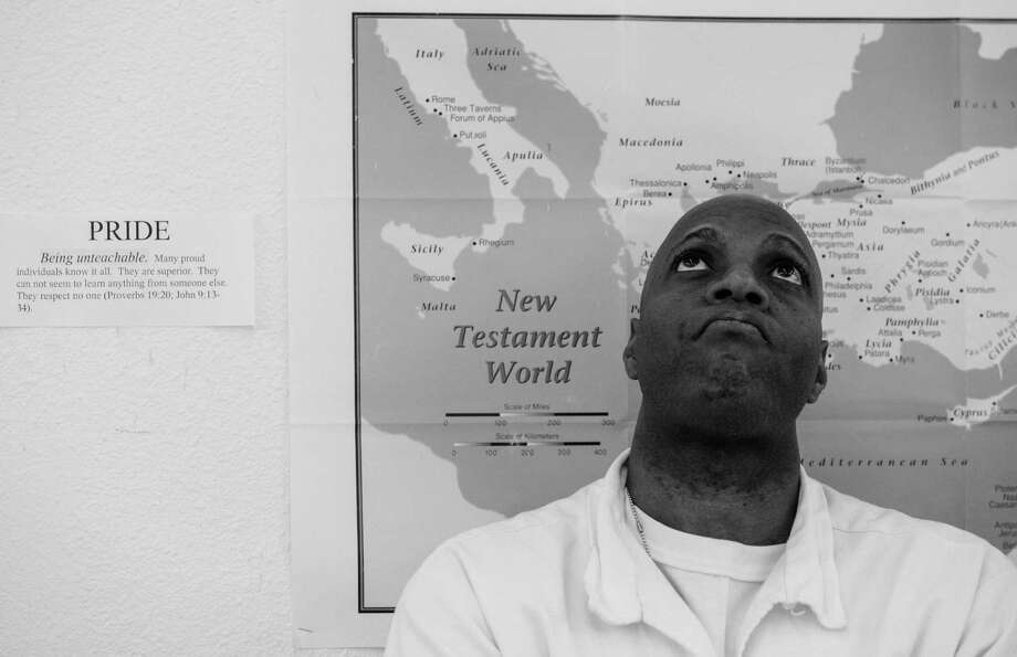 Inmate Cornelius Hawkins during seminary class Thursday March 6, 2014 at the Darrington Unit prison in Rosharon, TX.  A select group of inmates serving long term sentences are taking courses through Southwestern Baptist Theological Seminary. SBTS  started an accredited B.S. program in Biblical Studies at the Darrington Unit in the fall of 2011. Photo: Billy Smith II, Chronicle / © 2014 Houston Chronicle
