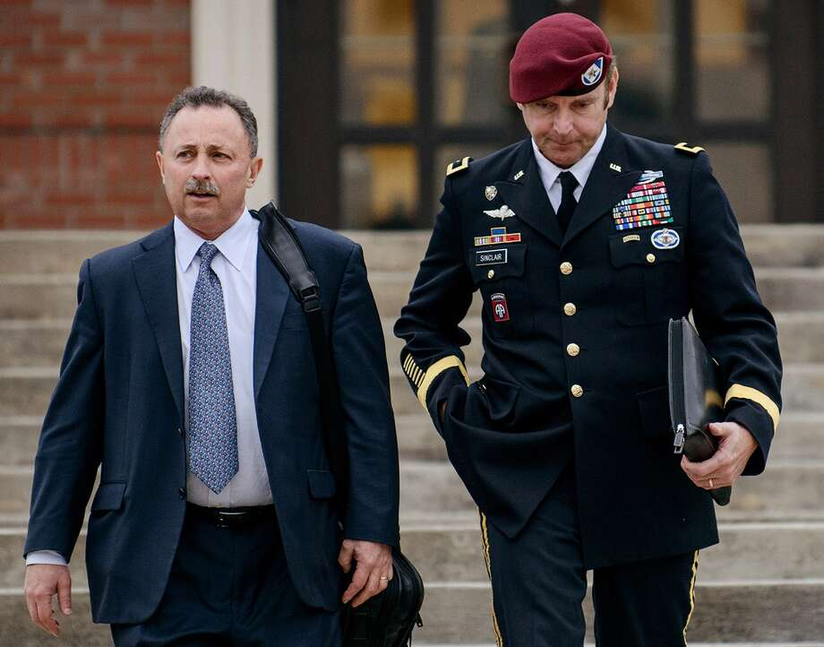 FILE - In this March 4, 2014, file photo, Brig. Gen. Jeffrey Sinclair, right, leaves the courthouse with his lawyers Richard Scheff, left, and Ellen C. Brotman, not pictured, following a day of motions at Fort Bragg, N.C. A news release Sunday, March 16, 2014, from lawyers representing Sinclair said that he will plead to lesser charges in exchange for having the sexual assault charges dropped along with two others that might have required Sinclair to register as a sex offender. Sinclair was accused of twice forcing a female captain to perform oral sex on him during a three-year extramarital affair. (AP Photo/The Fayetteville Observer, James Robinson, File) ORG XMIT: NCFAY501 Photo: James Robinson / The Fayetteville Observer