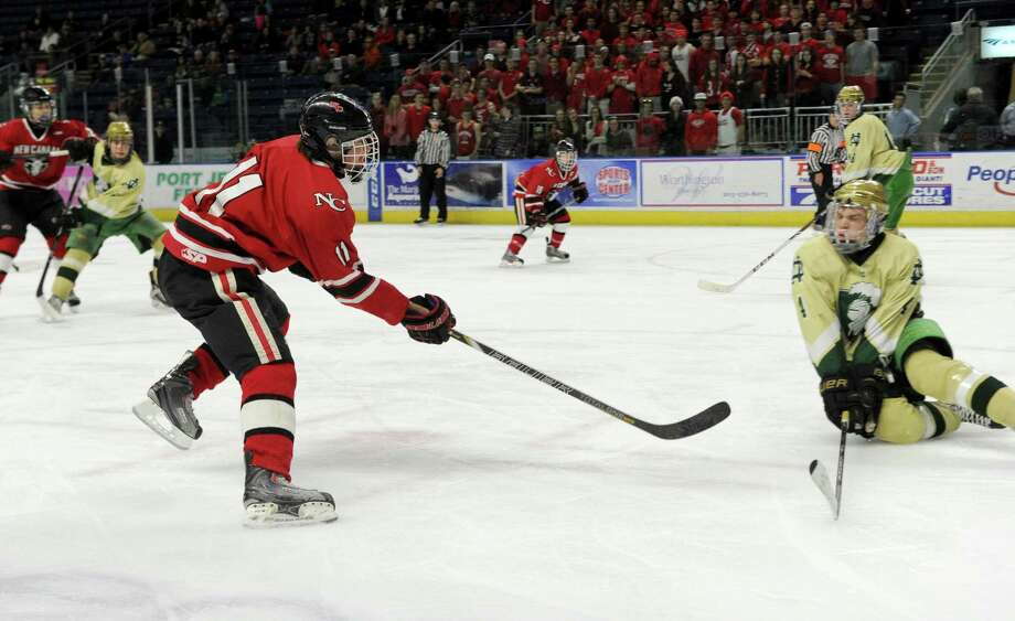 New Canaan's John O'Rourke looks to take a shot during Saturday's Division I semifinal game against Notre Dame-West Haven at Webster Bank Arena in Bridgeport, Conn., on March 15, 2014. Photo: Lindsay Perry / Stamford Advocate
