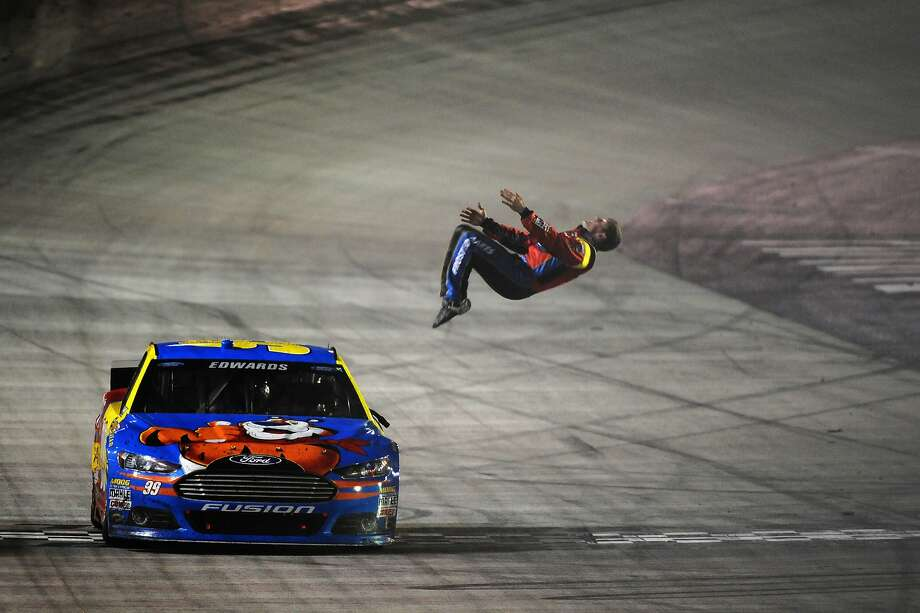Carl Edwards flips out over winning the Sprint Cup race in Bristol, Tenn. Photo: Jonathan Moore, Getty Images