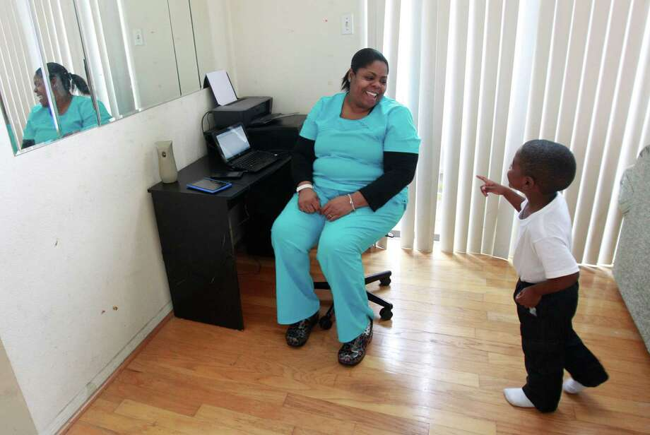 Monica Johnson makes enough money as a nurse that she no longer qualifies for rent assistance. A federal study will measure the success of others in the same Housing Authority program. Photo: Melissa Phillip, Staff / © 2014  Houston Chronicle