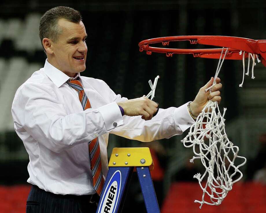Florida head coach Billy Donovan takes the net after the second half of an NCAA college basketball game against Kentucky in the Championship round of the Southeastern Conference men's tournament, Sunday, March 16, 2014, in Atlanta. Florida won 61-60. (AP Photo/John Bazemore) ORG XMIT: GAMS158 Photo: John Bazemore / AP