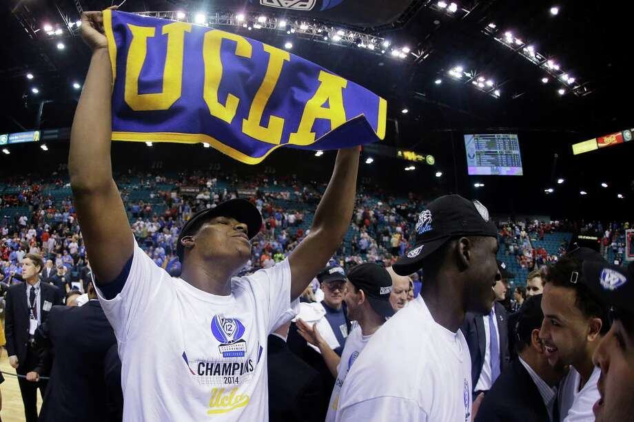 UCLA's Tony Parker holds up a UCLA banner after UCLA defeated Arizona 75-71 in the championship game of the NCAA Pac-12 conference college basketball tournament, Saturday, March 15, 2014, in Las Vegas. (AP Photo/Julie Jacobson)  ORG XMIT: NVJJ119 Photo: Julie Jacobson / AP