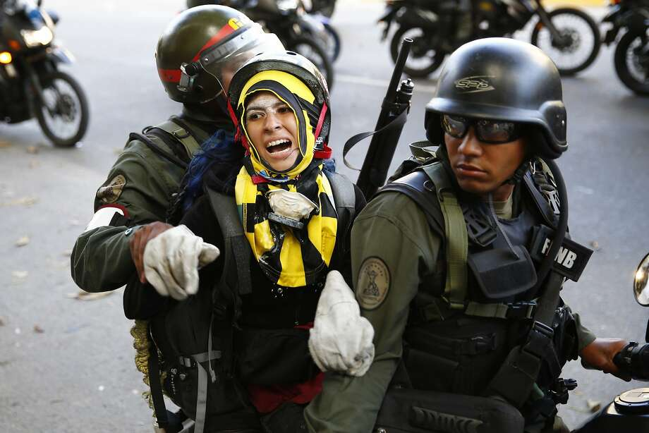 National guards transport an anti-government protester detainee during a protest against Nicolas Maduro's government in Caracas March 16, 2014. Venezuela's President Nicolas Maduro warned protesters in Caracas on Saturday to clear a square they have made their stronghold, or face eviction by security forces. Plaza Altamira, in upscale east Caracas, has been a focus of anti-government protests and violence during six weeks of unrest around Venezuela that has killed 28 people. REUTERS/Jorge Silva (VENEZUELA - Tags: POLITICS CIVIL UNREST) Photo: Jorge Silva, Reuters
