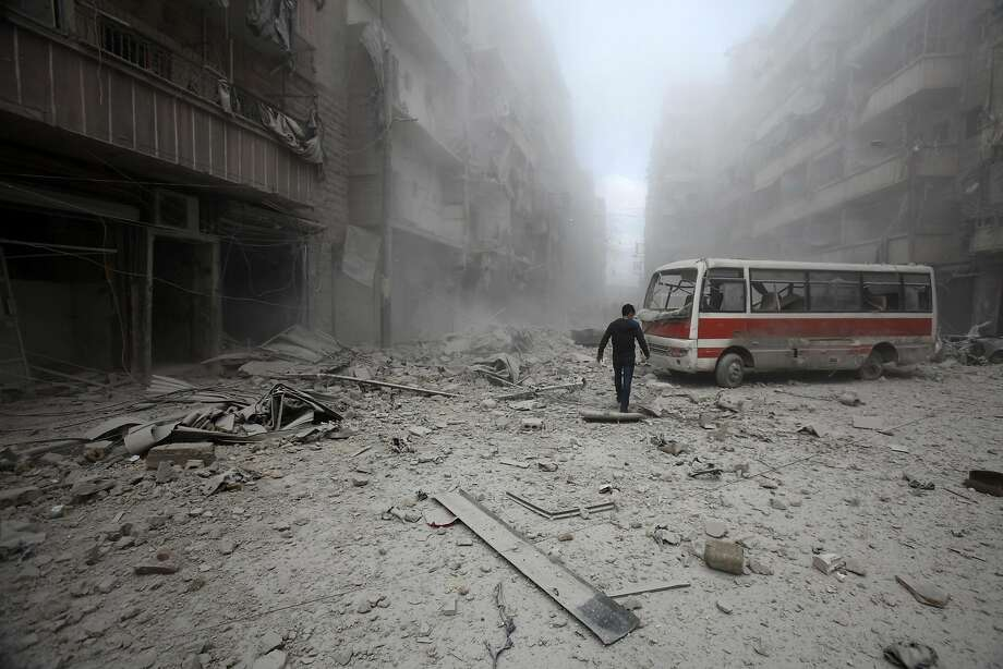 A man inspects the damage at a site hit by what activists said were barrel bombs dropped by forces loyal to Syria's President Bashar al-Assad in Aleppo's district of al-Sukari March 16, 2014. REUTERS/Ammar Abdullah (SYRIA - Tags: POLITICS CIVIL UNREST) Photo: Ammar Abdullah, Reuters