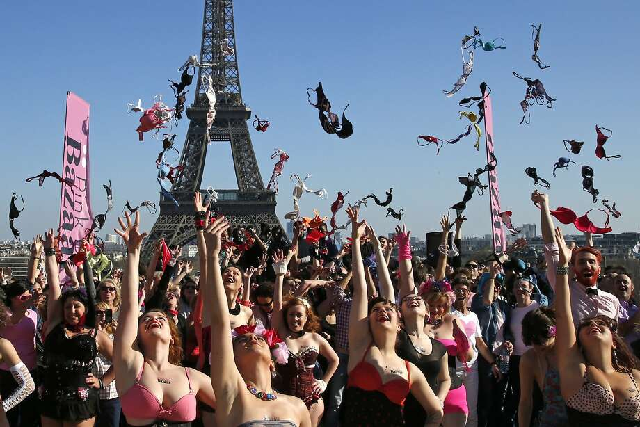 Women toss their bras during the 5th Pink Bra Spring and Bra Toss and help Push Up the Fight Against Breast Cancer event at the Trocadero Square near the Eiffel Tower in Paris March 16, 2014. Pink Bra Bazaar is a charity dedicated to breast health education and supporting women diagnosed with breast cancer. REUTERS/Benoit Tessier (FRANCE - Tags: SOCIETY) Photo: Benoit Tessier, Reuters