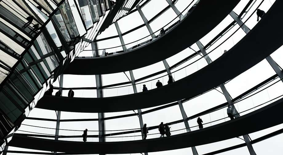 People visit the glass dome of the Reichstag building in Berlin, Germany, Sunday, March 16, 2014. (AP Photo/dpa, Kay Nietfeld) Photo: Kay Nietfeld, Associated Press
