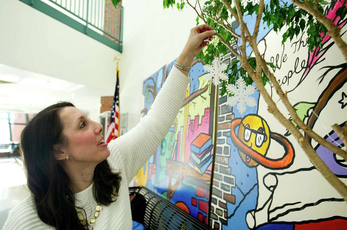 Jessica Lawler helps decorate at Scofield Magnet Middle School for a dance.