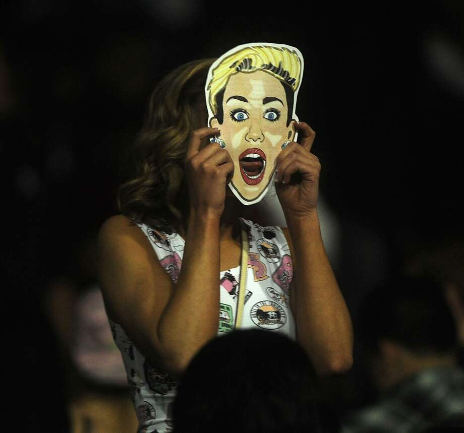 A fan wears a mask before the Miley Cyrus show at the Toyota Center Sunday March 16, 2014.(Dave Rossman/For the Chronicle)