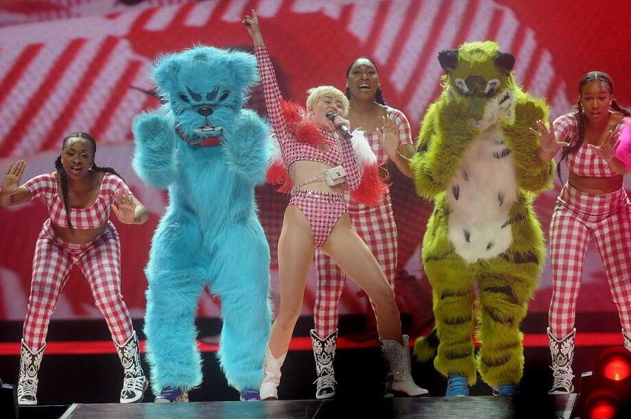 Miley Cyrus performs during her Bangerz Tour at the Toyota Center Sunday March 16, 2014.(Dave Rossman/For the Chronicle)