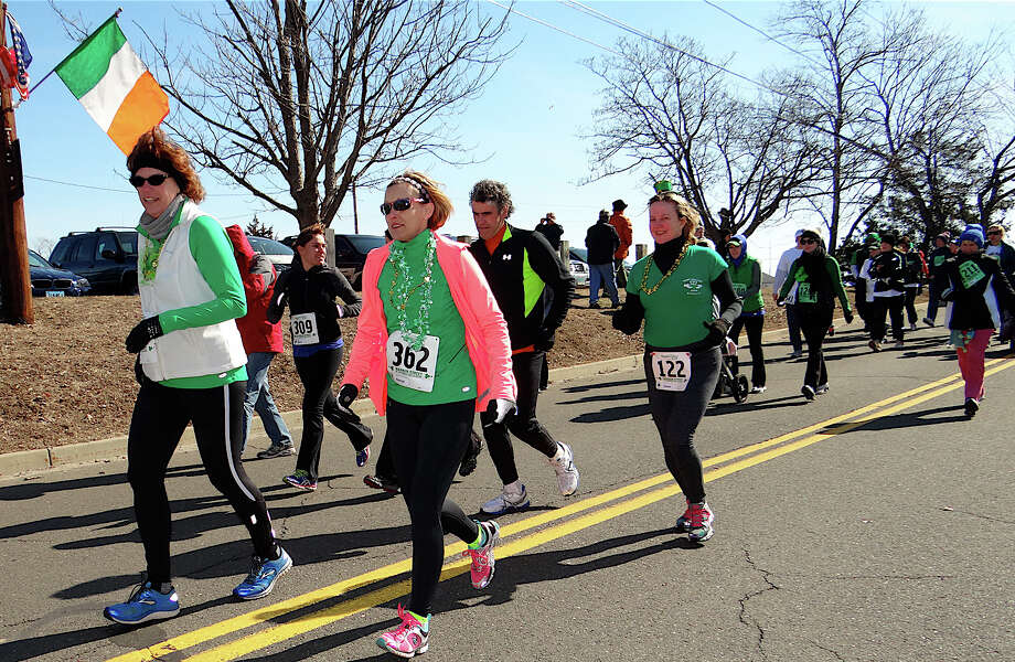 Runners hit theit stride Sunday morning in the 19th annual 19th annual Warren Street St. Patrick's Day Classic at Jennings Beach. Photo: Mike Lauterborn / Fairfield Citizen