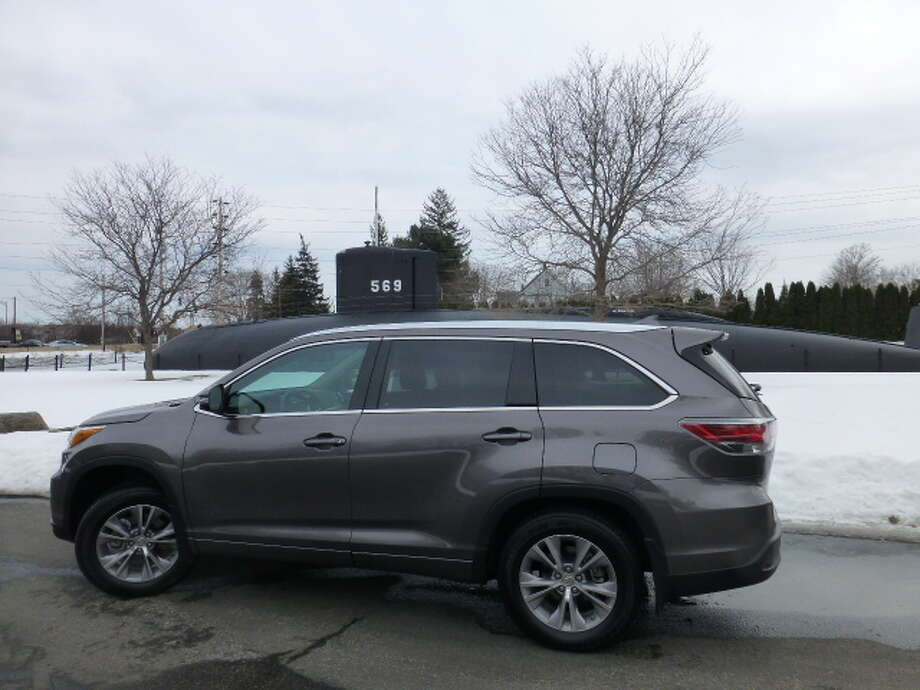 The 2014 Toyota Highlander, with the submarine USS Albacore in the background, at Albacore Park, Portsmouth, N.H. The Albacore served as a test submarine in the fleet for nearly 20 years and was decommissioned in September 1972. She is now a tourist attraction in Portsmouth, not far from the naval shipyard where she was built more than 60 years ago.