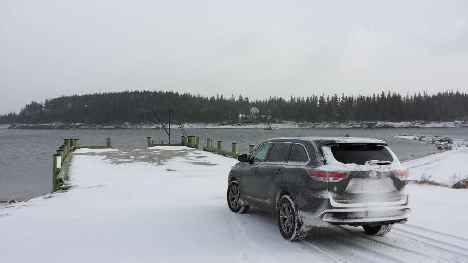 The 2014 Toyota Highlander XLE at the Naskeag Point pier, Brooklin, Maine, in a brief lull during a March blizzard. (All photos by Michael Taylor)