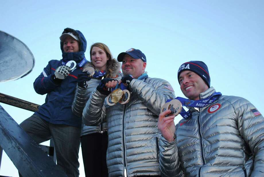 From left, alpine skier Andrew Weibrecht, luger Erin Hamlin and bobsledders Steven Holcomb and Steve Langton display their 2014 Sochi Winter Olympic medals (and for Holcomb a gold medal from the 2010 Vancouver Olympics) after a parade to welcome them and other Olympians home to Lake Placid, N.Y., Sunday, March 16, 2014. (AP Photo/Adirondack Daily Enterprise, Matthew Turner) Photo: Matthew Turner / Adirondack Daily Enterprise