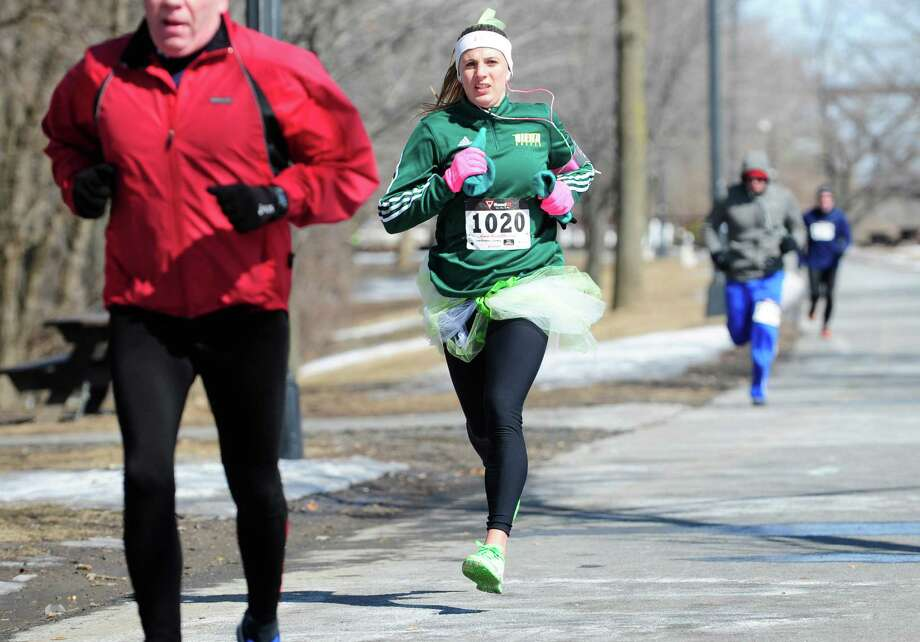 Chelsea DeSalvatore of Clifton Park heads to the finish line during the First Annual Catch The Leprechaun 5K run at the Corning Preserve on Sunday, March 16, 2014, in Albany, N.Y.(Paul Buckowski / Times Union) Photo: Paul Buckowski / 00025743A