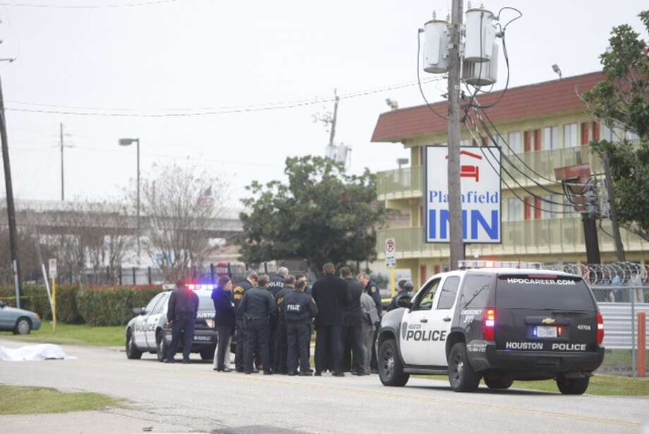An officer shot a robbery suspect about 7:30 a.m. Monday outside the Plainfield Inn at 9638  Plainfield, near the Southwest Freeway, according to the Houston Police  Department.