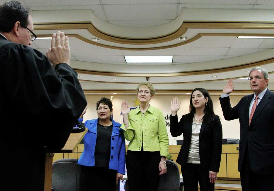 File - In this May 7, 2013 file photo, judge Alex Gonzalez, from left,  administers an oath to Blanca Enriquez, Judy Castleberry, Carmen Arrieta-Candelaria and Dee Margo, all members appointed to a board of managers at the EL Paso Independent School District's offices in El Paso, Texas. The school board in March approved a review to determine if staffers since 2008 tried to manipulate student transfer credits. (AP Photo/Juan Carlos Llorca, File) Photo: Juan Carlos Llorca, STF / AP
