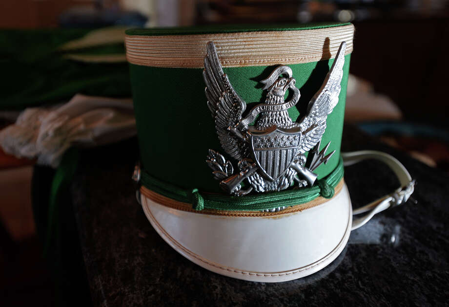 One of the hats worn by the Colleens sits on a countertop at the home of Monica McDonald, former director of the marching band. The 1979 Bishop Byrne High School marching band, the Colleens, toured Ireland and marched in a St. Patrick's Day parade. Though the school closed its doors in 1983, several of the Colleens still participate in community events, such as recent Mardi Gras parades. Photo taken Thursday, 3/13/14 Jake Daniels/@JakeD_in_SETX Photo: Jake Daniels / ©2014 The Beaumont Enterprise/Jake Daniels