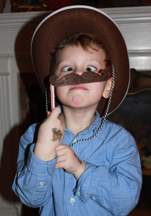 My grandson, Trevor Ian Robertson,had a fascination about having a moustache for Go Texan DayLibby Klotter