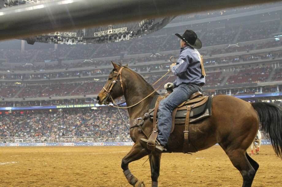 I took this picture of a cowboy at the Houston Livestock Show and Rodeo on March 12. He was riding around making sure none of the competitors got hurt. Reagan Gertner