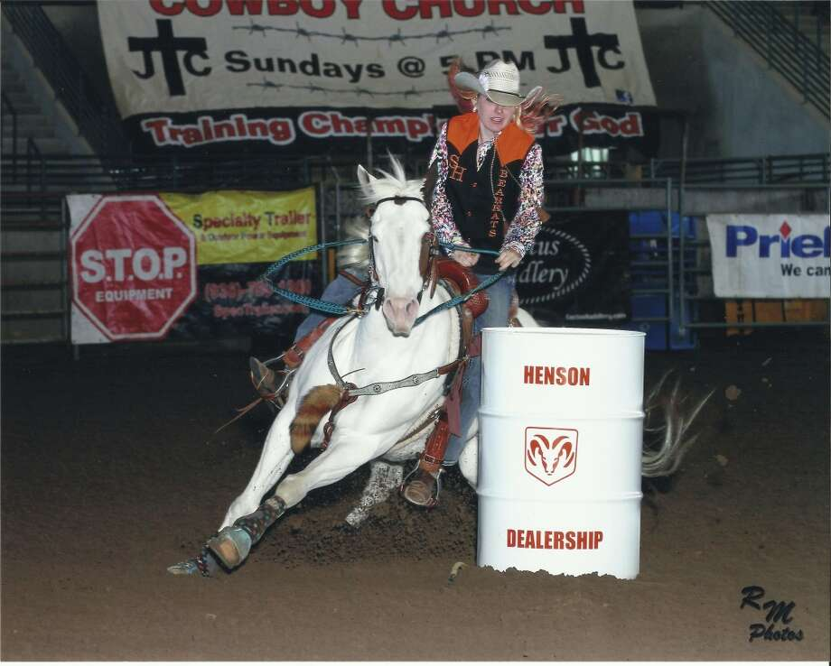 Running barrels at a college rodeo on my registered APHA horse that I plan to run in the Houston Livestock Show & Rodeo APHA barrel racing competition next year.Kendal Dickson