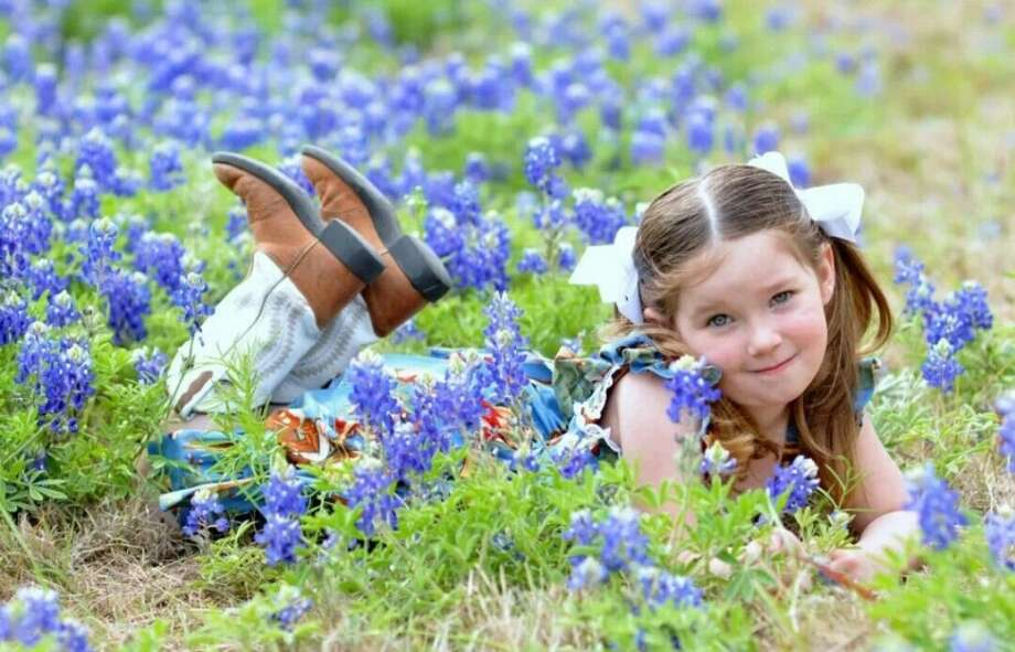 This picture is of my daughter Abby laying in the field of bluebonnets last spring in Kingwood, TX. She is wearing her boots and a dress that I purchased from one of the Houston Livestock Show vendors at last year's (2013) rodeo. This picture definitely shows Abby's personality of being a Cowgirl Diva!Brandy Whisenant