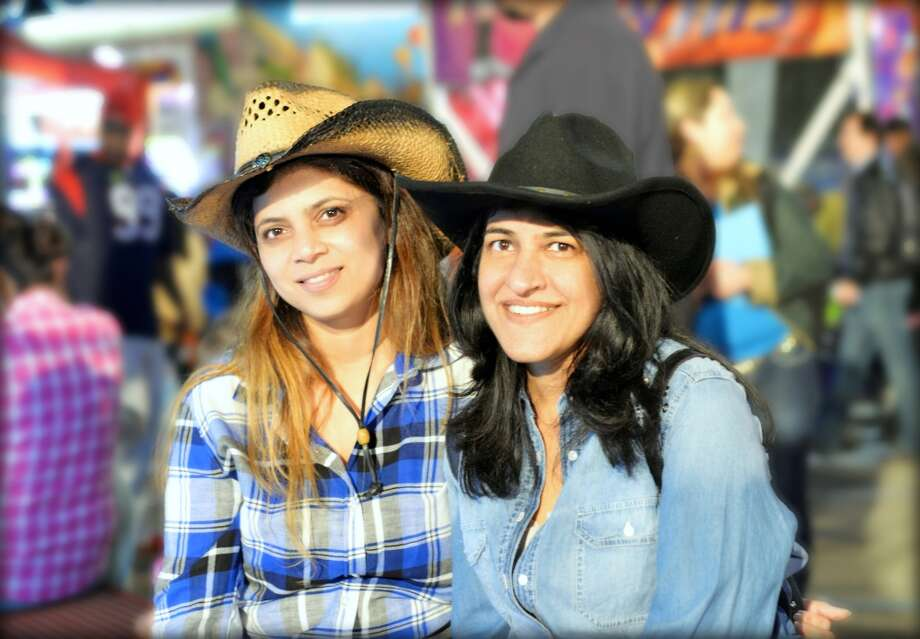 My lovely wife, Preeti, and her beautiful friend, Anamika, taking it easy at the rodeo carnival. Viraj Pikle Photo: Picasa