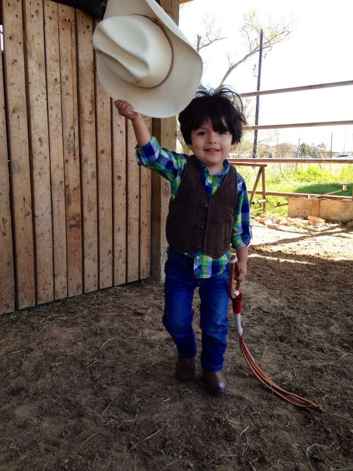 Cowboy Eli Alexander ready for his morning ride with his horse Lucero. He loves the cowboy life. Alex Solis