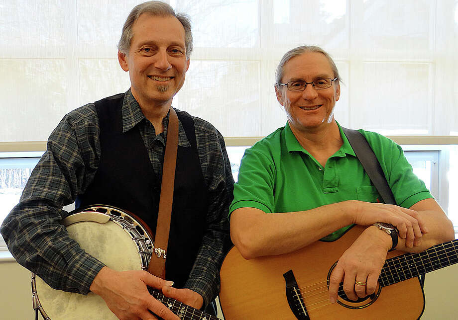 Paul Neri and Pierce Campbell performing Irish music as The Kerry Boys at Fairfield Public Library Saturday afternoon. Photo: Mike Lauterborn / Fairfield Citizen