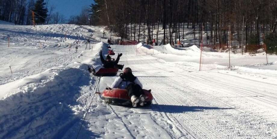 A day of family fun at Willard Mountain can brighten any mood. Read more about a day of downhill tubing. Photo: Sonja Stark