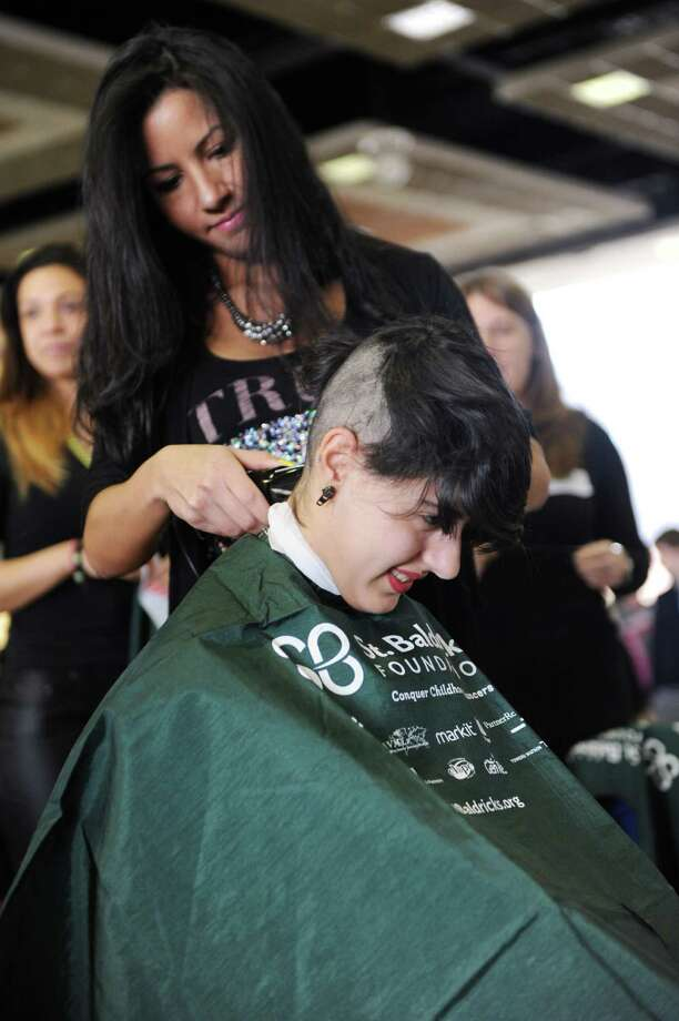 Senior Mariana Cordero has her head shaved for a fundraiser to benefit the St. Baldrick's Foundation at Greenwich High School on Monday March 17, 2014. Photo: Dru Nadler / Stamford Advocate Freelance