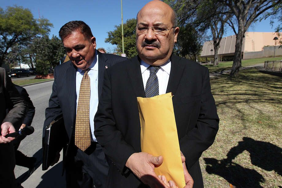 San Antonio attorney Al Acevedo, Jr, right, and his attorney Frank Perez, leave the U.S. Federal Courthouse after Acevedo plead guilty on charges of bribing a state district judge, Monday, March 17, 2014. Photo: Jerry Lara, San Antonio Express-News / ©2013 San Antonio Express-News