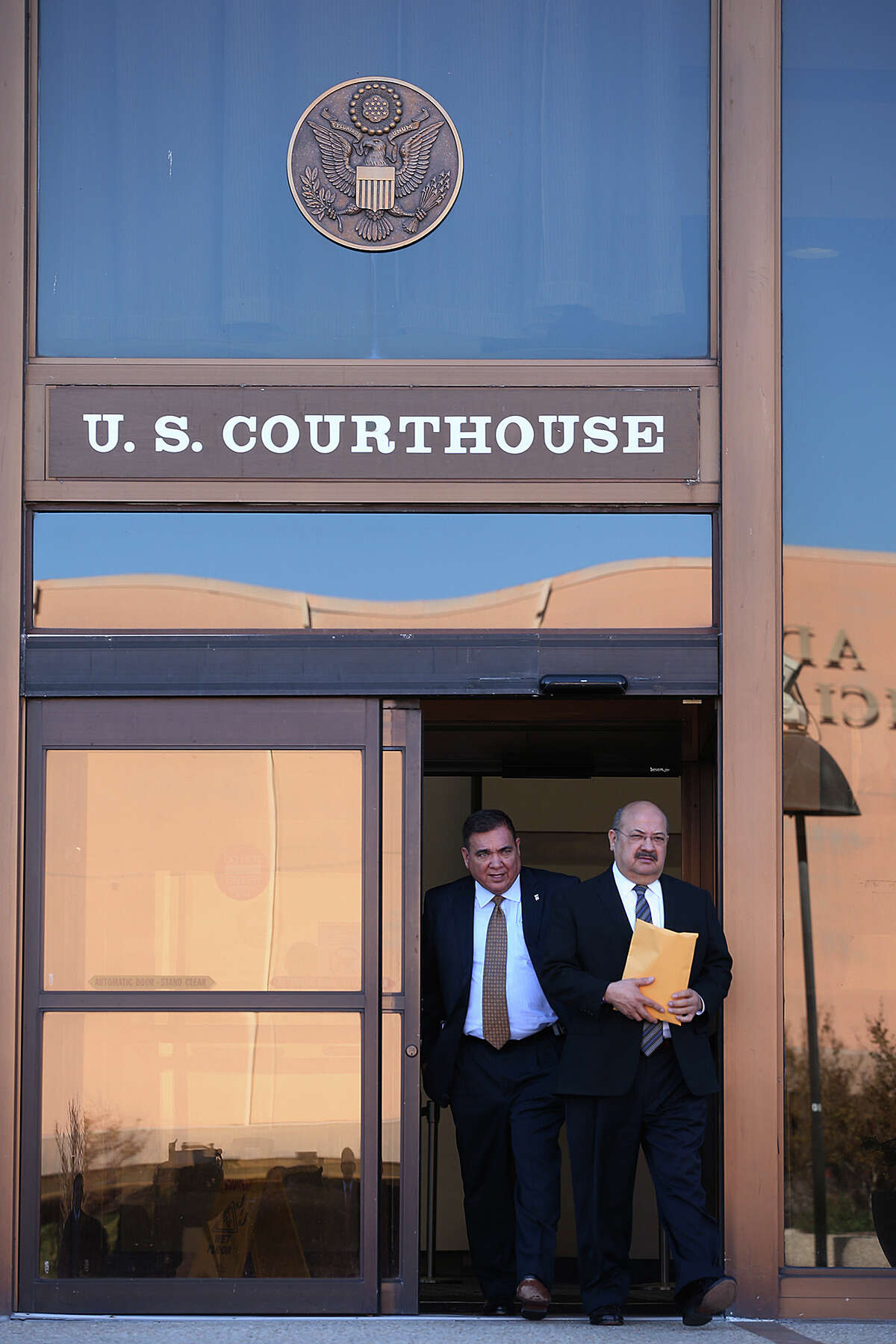 San Antonio attorney Al Acevedo, Jr, right, and his attorney Frank Perez, leave the U.S. Federal Courthouse after Acevedo plead guilty on charges of bribing a state district judge, Monday, March 17, 2014.
