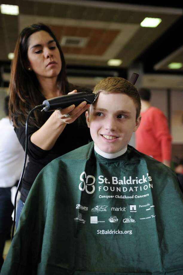 GHS Junior James Cavataro has his head shaved for a fundraiser to benefit the St. Baldrick's Foundation at Greenwich High School by Carolina Vargas of Generations in Old Greenwich on Monday March 17, 2014. Photo: Dru Nadler / Stamford Advocate Freelance