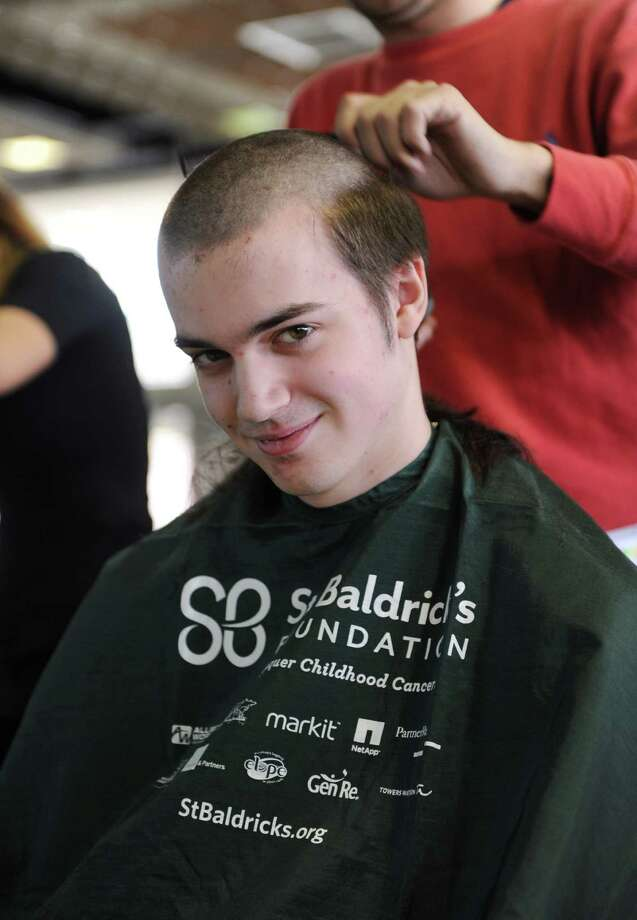 GHS Junior Patrick Rooney  has his head shaved for a fundraiser to benefit the St. Baldrick's Foundation at Greenwich High School by Carolina Vargas of Generations in Old Greenwich on Monday March 17, 2014. Photo: Dru Nadler / Stamford Advocate Freelance