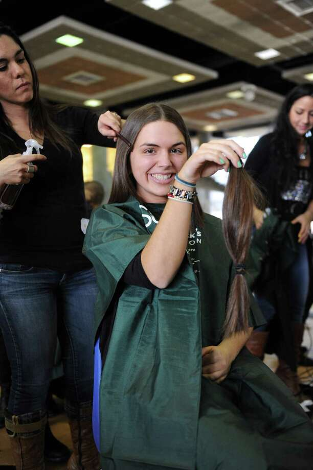 GHS Junior Casey Haid has 12 inches of her hair cut off for a fundraiser to benefit the St. Baldrick's Foundation at Greenwich High School on Monday March 17, 2014. Photo: Dru Nadler / Stamford Advocate Freelance