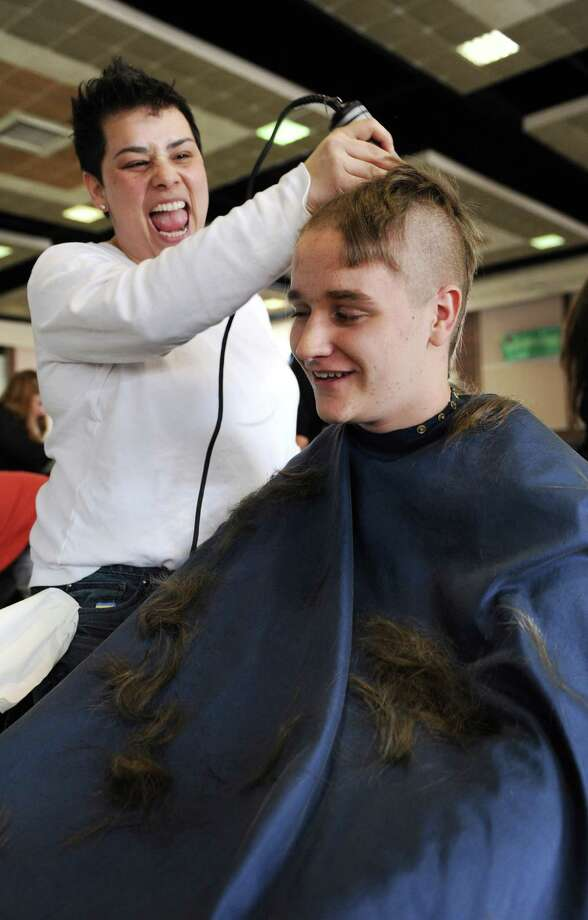 Nick Marchak has his head shaved for a fundraiser to benefit the St. Baldrick's Foundation by Kelly Rosa at Greenwich High School on Monday March 17, 2014. Photo: Dru Nadler / Stamford Advocate Freelance